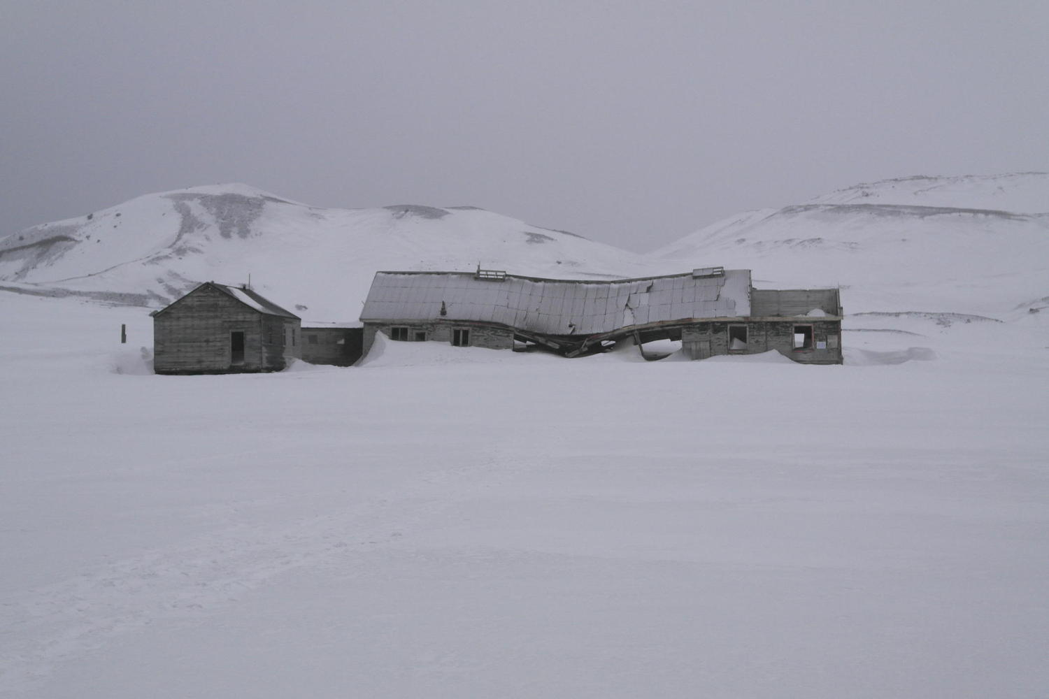 An ancient whaling hut on Deception Island grows ever nearer to collapse