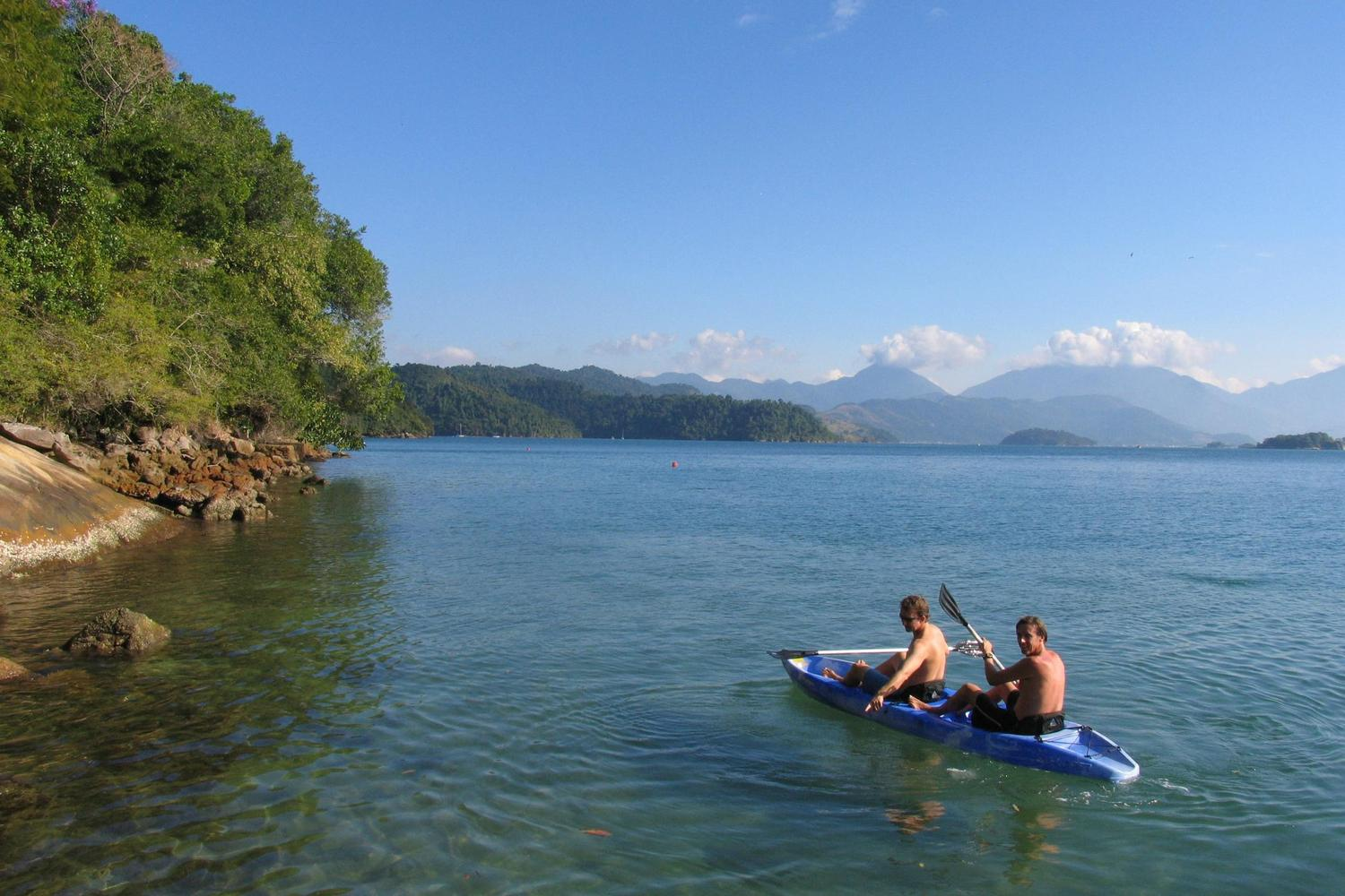 Kayaking the clear waters near Paraty