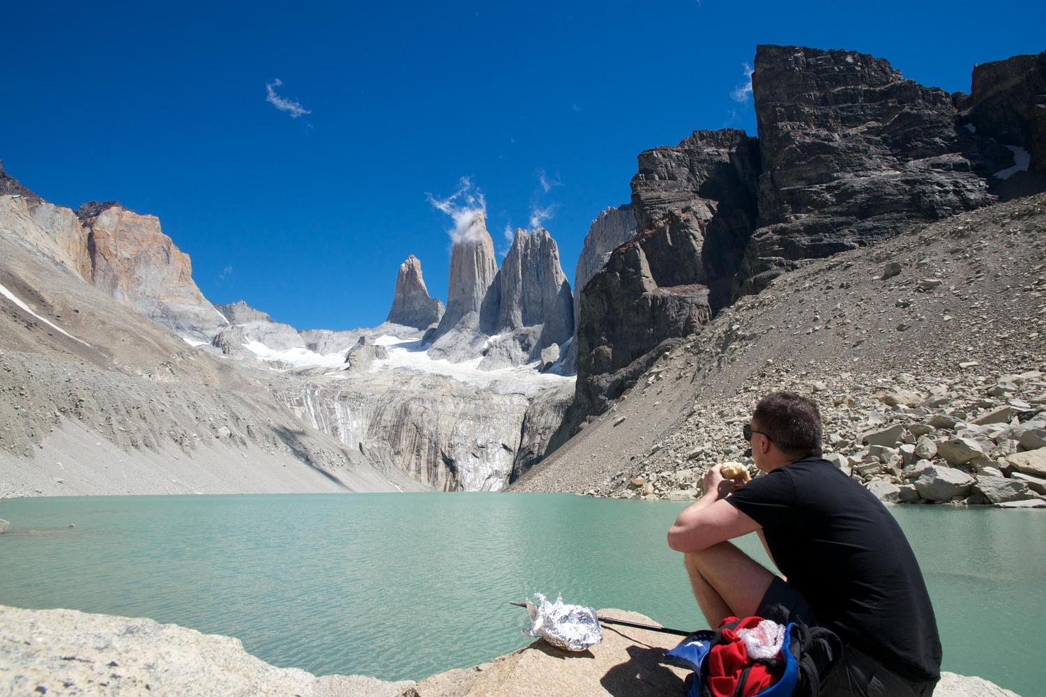 Taking a well-earned break at the glacial lake at the foot of the Paine Towers