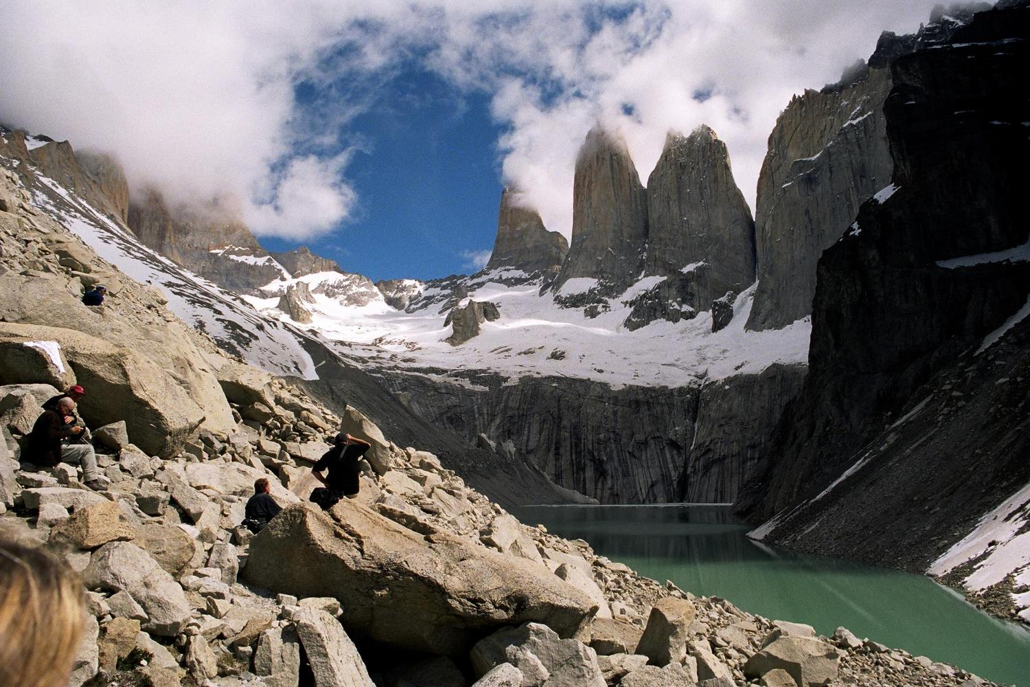 Clouds parting to reveal the peaks of the towers in Chile's Torres del Paine