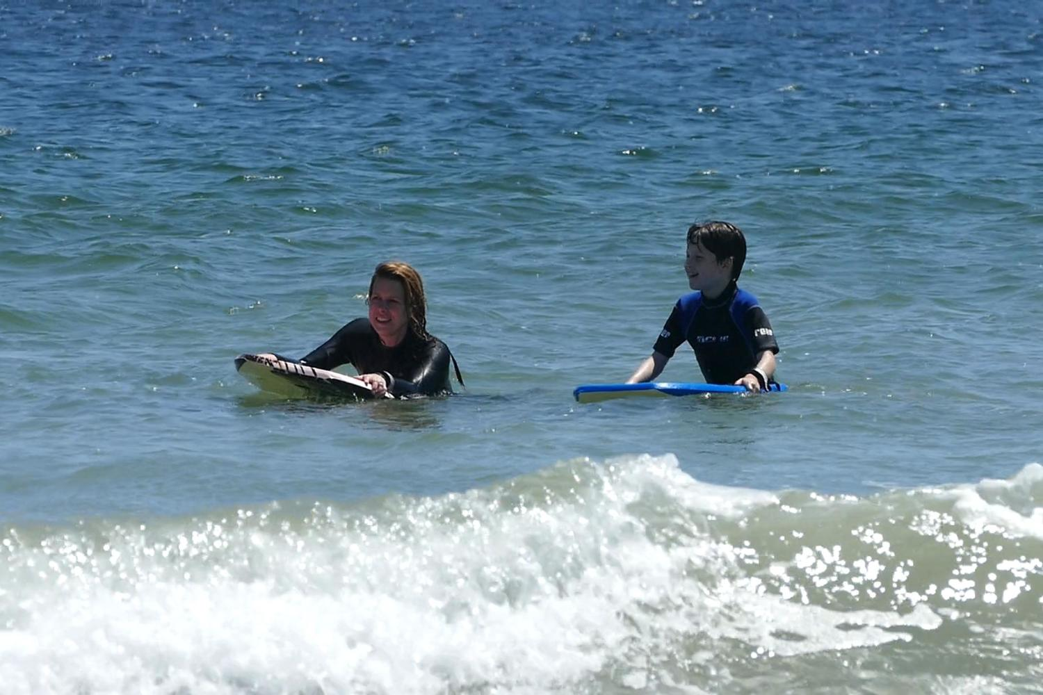 Costa Rica mother and son surfing