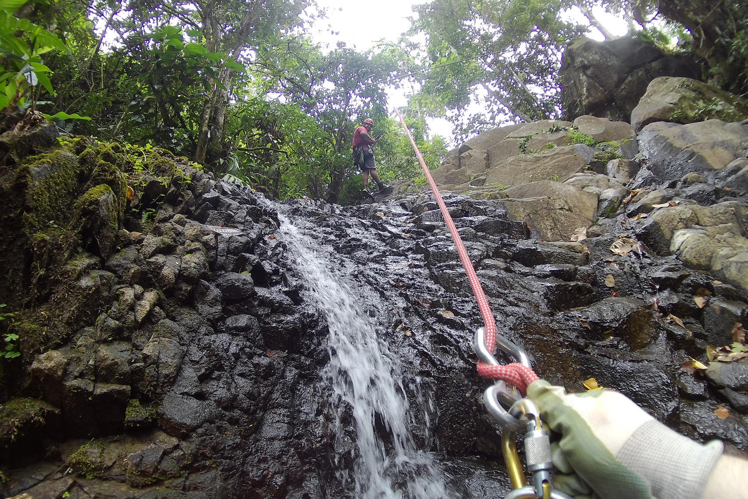 Descending Turrialba's waterfalls by means of a rappel