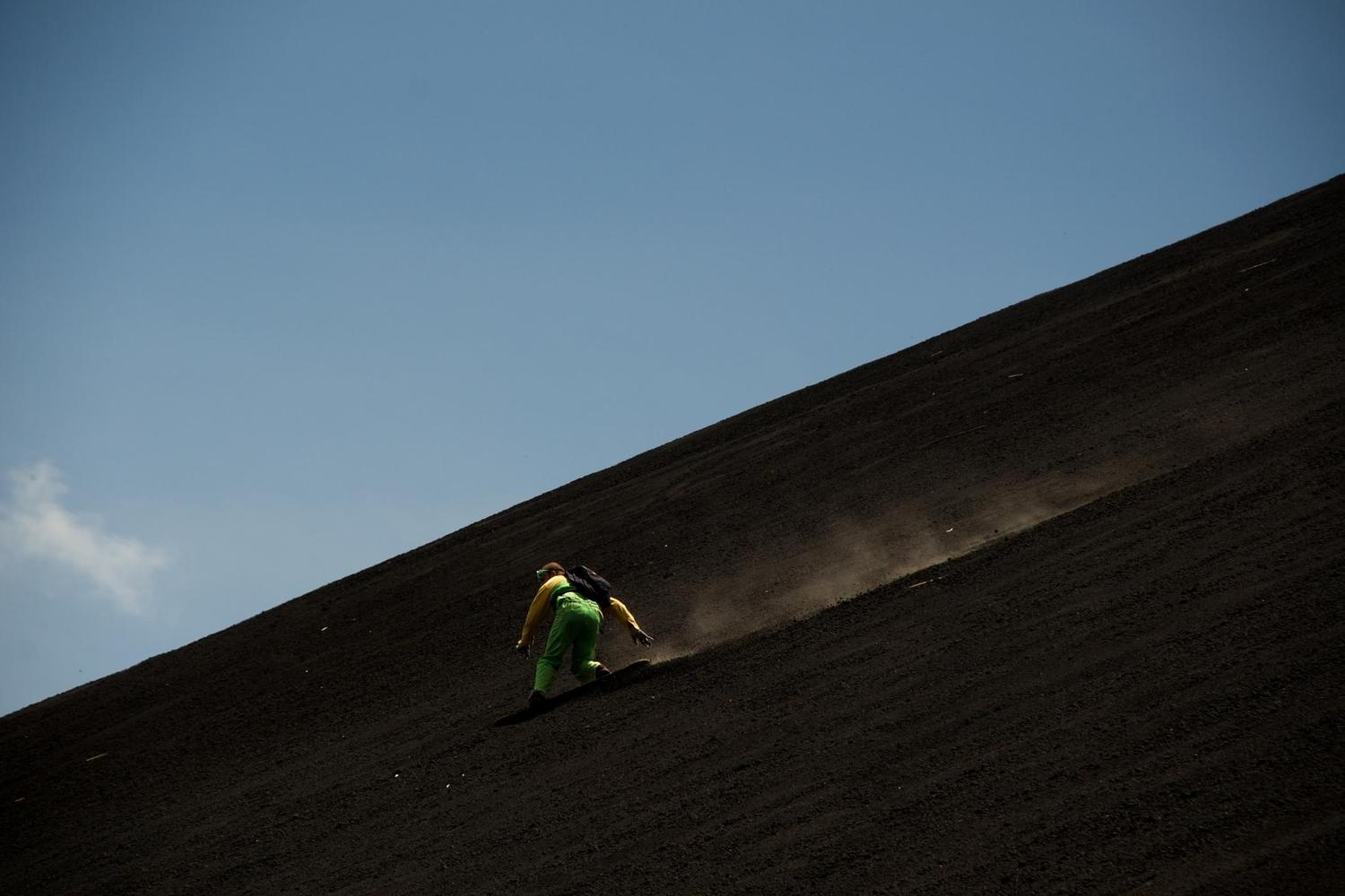 Sandboarding down the slopes of Cerro Negro volcano