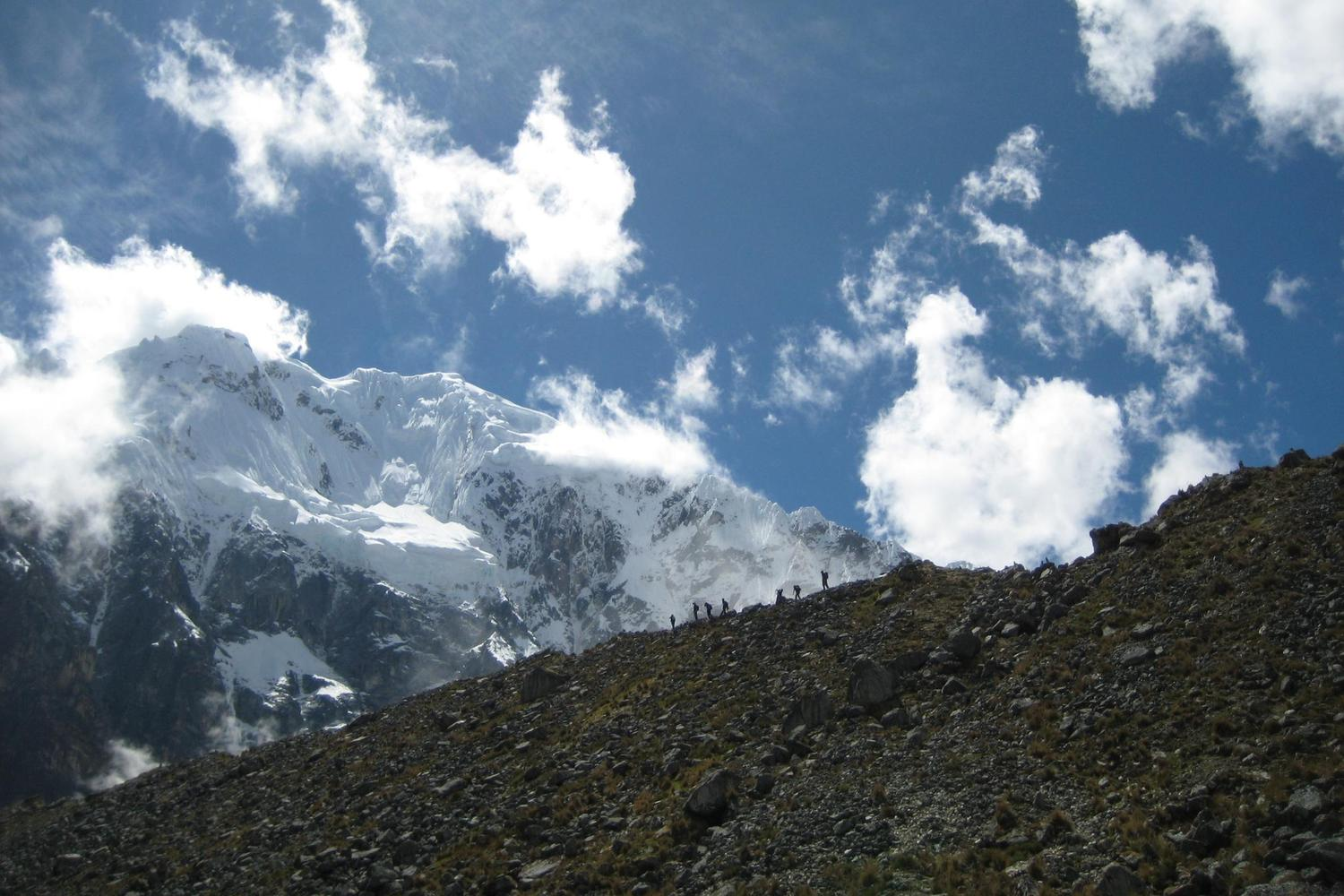 Walking along a ridge in front of Salkantay, Peru