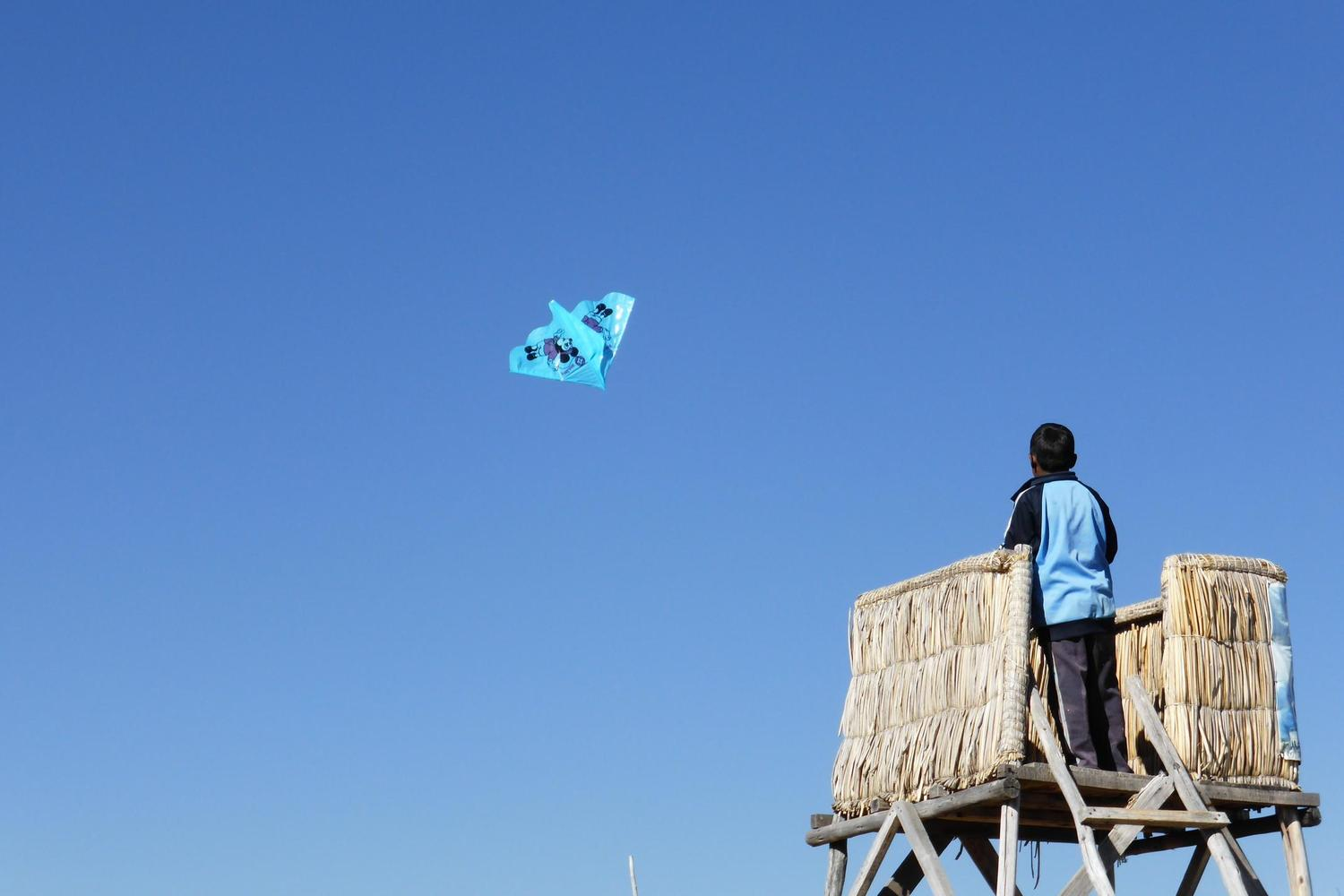 Flying a kite from the Uros floating islands on Lake Titicaca