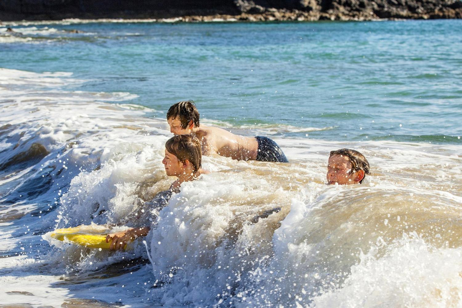 Children enjoying the great surf along the Cantabrian coast