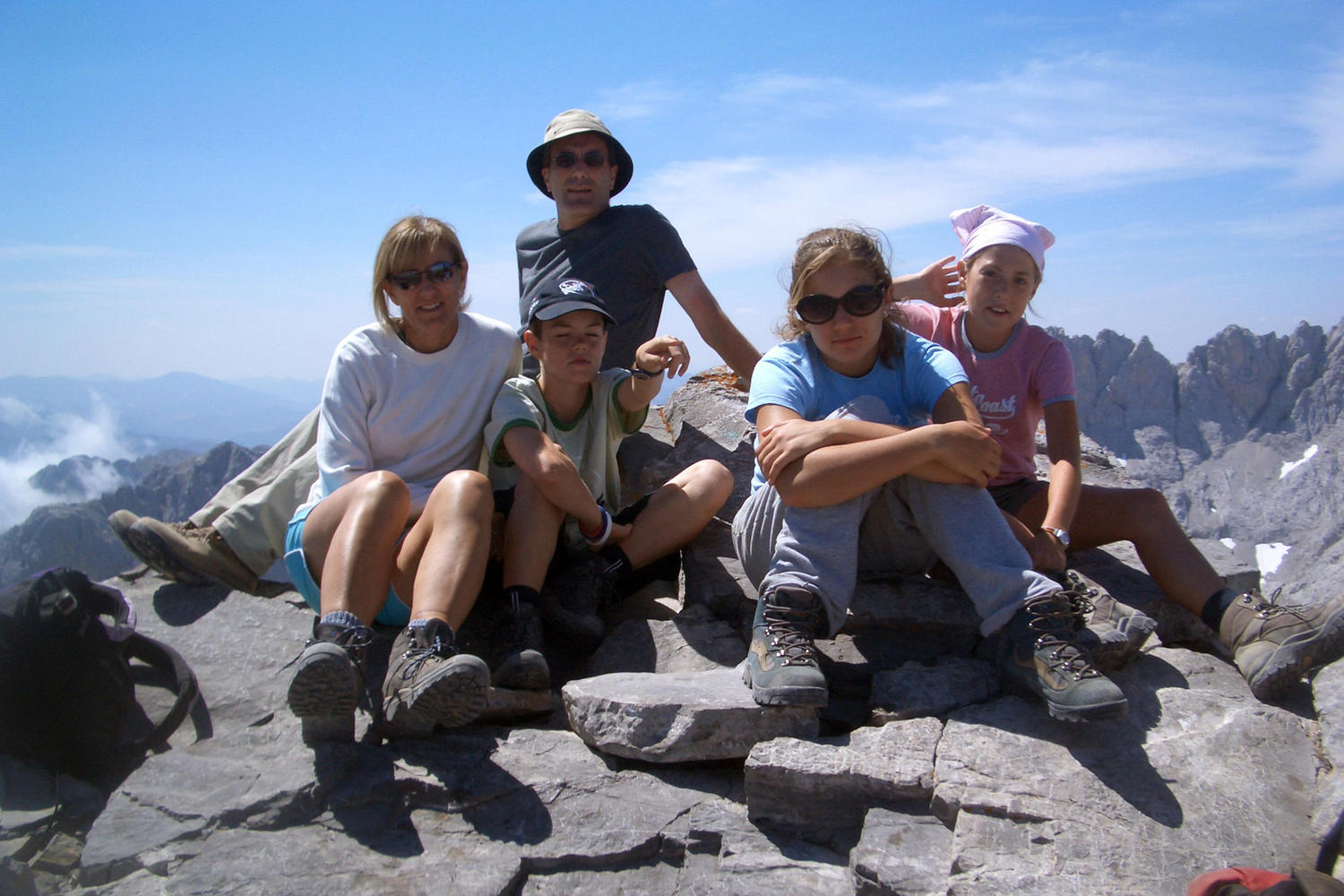 Family on top of Horcados Rojos peak in the Picos de Europa