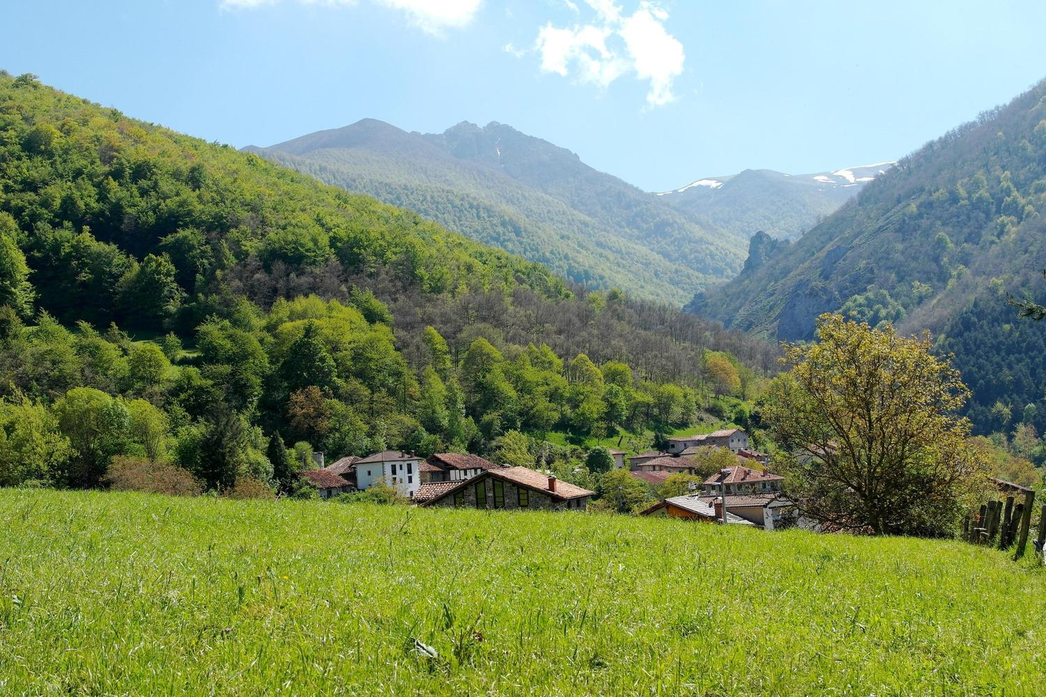 Walking over meadows to the tiny village of Trevino, Picos de Europa