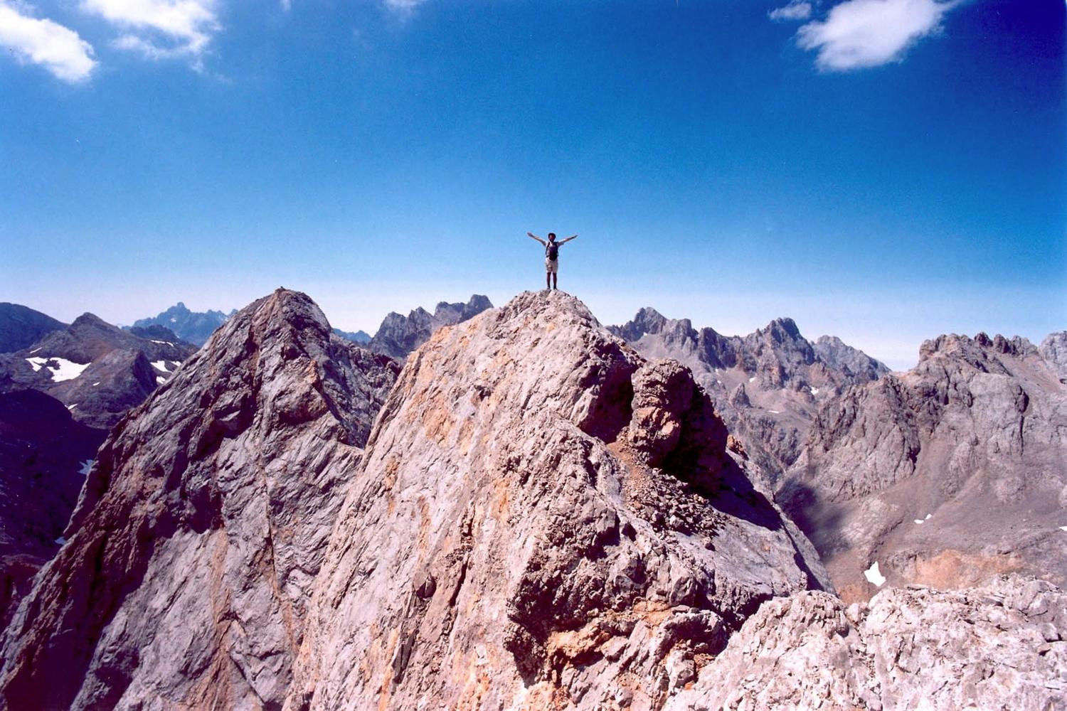 Standing high on the peak of Horcados Rojos in the Picos de Europa